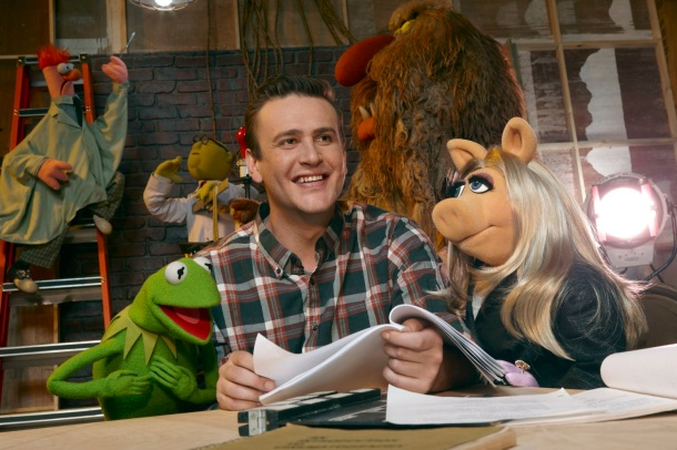 "Kermit the Frog, Jason Segel and Miss Piggy in ""The Muppets."""